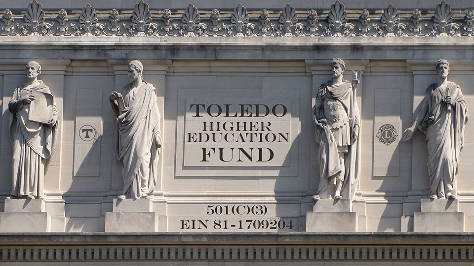 A marble facade of Roman scholars support the Toledo Washington Higher Education Fund. Illustration by Morgan Online Media.